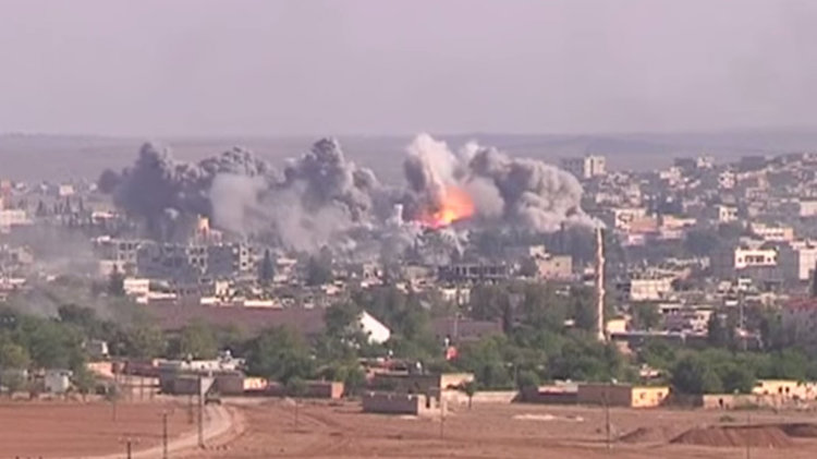 Photo: Coalition airstrike on ISIL position in Kobani, October 2014. Credit: Wikimedia Commons.
