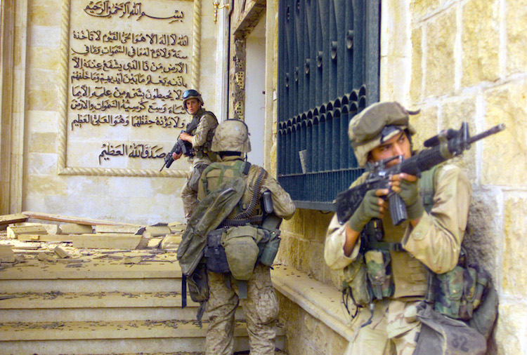 Photo: U.S. Marines from 1st Battalion 7th Marines enter a palace during the Fall of Baghdad. Credit: Wikimedia Commons
