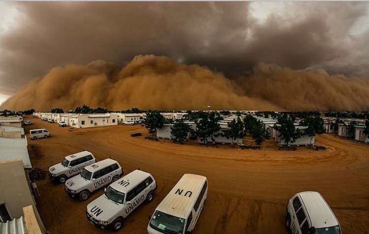 Photo: A sandstorm hits the UN mission in El Fasher, North Darfur, Sudan. The UN has installed carlogs in its vehicles there to measure idling. Credit: Adrian Dragnea, UNAMID.