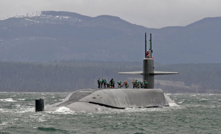 Photo: The USS Ohio sailing in the Strait of Juan de Fuca. The Trident nuclear submarine has been converted to a guided missile submarine. It was first launched in 1979, and was the original nuclear submarine in the U.S. Pacific Fleet stationed at what is now Naval Base Kitsap. (Steve Ringman/The Seattle Times)