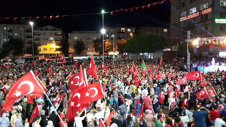 Photo: Anti-coup protesters after 15 July 2016 Turkish coup d'état attempt in Bağcılar, İstanbul, Turkey. Credit: Wikimedia Commons.